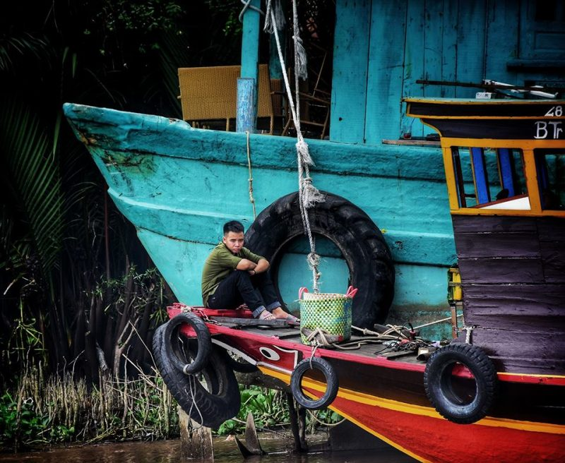 Inside people Mekong river by Dino Morri