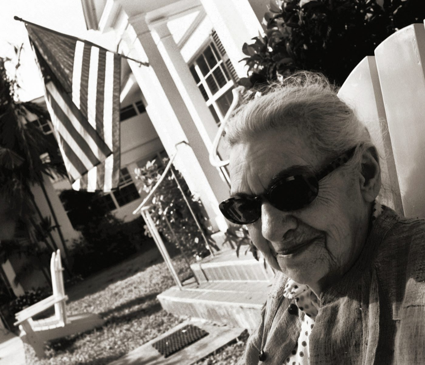Madje Has Dementia by Maggie Steber (23): Madje with dark glasses: Madje Steber sits in the front lawn of Bay Oaks, an assisted living facility in the heart of Miami, Florida, after being moved there by her daughter when she could no longer live alone. Madje loved it and blossomed. There were little dogs and a few cats that lived there. She only stayed here for one year because she began to wander and had to move to Midtown Manor in Hollywood, Florida. COOL MADJE