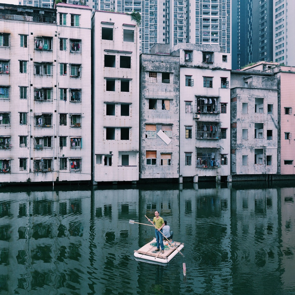 Men in a Pond by Yuyang Liu: Guangzhou, China. 2015. Two men were fishing in the pond of Xian Village which is in the center of Guangzhou city. There was a conflict between locals and real estate developers for more than 7 years because of the uneven compensation and the corruption of Xian village leaders. Xian village is an epitome of China's urbanization.