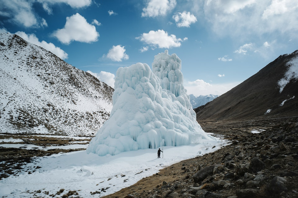 The Ice Stupas by Ciril Jazbec: One way to fight climate change: Make your own glaciers. As snows dwindle and glaciers recede, people in the mountains of northern India are building huge ice cones called Ice Stupas that provide water into summer. This 33,5m high Ice Stupa near the village of Shara Phuktsey won first prize for the largest Ice Stupa in a 2019 competition. Its nearly two million gallons of stored water which helped irrigate fields in four villages. The stupa also drew tourists: Ice climbers came to scale its steep flanks.