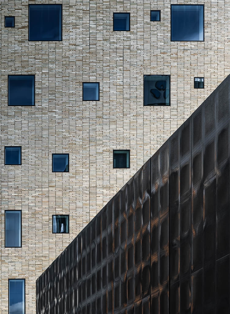 MIFA 2021 Honorable Mention 2021 / Architecture / Buildings The Britomart    Photographer Sarah Caldwell / New Zealand A new hotel in Auckland with a feature of the blue windows in the brick building.